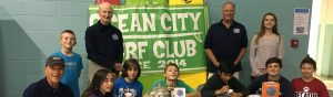 kids in front of ocean city surf club sign